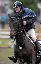 Maurice Beatson rides My Gollywog in a wet and muddy round 4 of the FEI World Cup qualifier, Taupo, New Zealand, Saturday, December 17, 2011. Credit: SNPA / Kerry Marshall