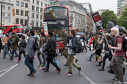 London, May 27th 2015. Protesters march from Trafalgar Square to Whitehall following a march througfh the streets of the West End as they demonstrate against the Tories' ongoing campaign of austerity on the day the Queen delivered her speech to Parliament