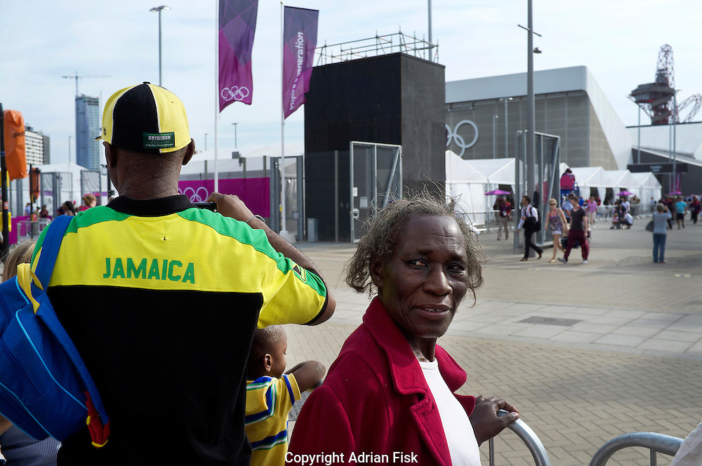 A family supporting Jamaica stand close to the entrance to the Olympic Park at Stratford