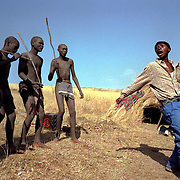 IPMG0367 South Africa, Flagstaff, 1998: Xhosa initiates sing traditional songs during their seclusion, having undergone the circumscision rite of passage to manhood in tribal Xhosa culture in the former Transkei homeland, near Flagstaff, July 1998...Photograph by Greg Marinovich/South Photographs