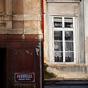 "SHOT 11/23/08 4:53:02 AM - Deteriorating wall and window in Hradcany section of Prague, Czech Republic. Hrad?any, the Castle District, is the Prague district surrounding the Prague Castle. Prague is the capital and largest city of the Czech Republic. Its official name is Hlavní m?sto Praha, meaning Prague, the Capital City. Situated on the River Vltava in central Bohemia, Prague has been the political, cultural, and economic centre of the Czech state for over 1100 years. The city proper is home to more than 1.2 million people, while its metropolitan area is estimated to have a population of over 1.9 million. Since 1992, the extensive historic centre of Prague has been included in the UNESCO list of World Heritage Sites. According to Guinness World Records, Prague Castle is the largest ancient castle in the world. Nicknames for Prague have included ""the mother of cities"", ""city of a hundred spires"" and ""the golden city"". Since the fall of the Iron Curtain, Prague has become one of Europe's (and the world's) most popular tourist destinations. It is the sixth most-visited European city after London, Paris, Rome, Madrid and Berlin. Prague suffered considerably less damage during World War II than some other major cities in the region, allowing most of its historic architecture to stay true to form. It contains one of the world's most pristine and varied collections of architecture, from Art Nouveau to Baroque, Renaissance, Cubist, Gothic, Neo-Classical and ultra-modern..(Photo by Marc Piscotty / © 2008)"