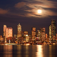 WA10057-00...WASHINGTON - Moon peaking over the clouds of downtown Seattle and Elliott Bay from West Seattle.