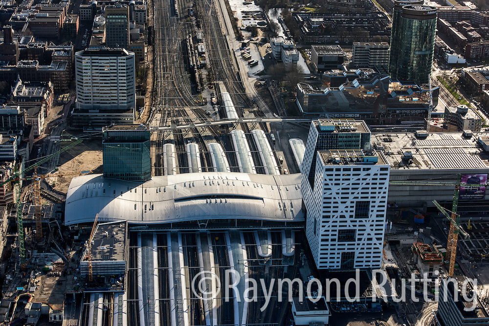 Netherlands - New railroad Station CS Utrecht. The largest and busiest train station in the Netherlands is officially open. Utrecht Central Station was once built for approximately 35 million passengers per year. This number is constantly increasing and is expected to reach one hundred million passengers in 2030. Benthem Crouwel Architects has been involved in the development of the train station since 2003. Thirteen years later, the new public transport terminal that will house train, bus and tram platforms under one undulating roof, has opened.  Next to the station is the New City Hall Utrecht. Municipal workers from thirteen different locations are housed in one collective municipal office.<br /> The building is next to the Central Station, and was built in the shape of the letter 'U' for Utrecht.  photo raymond rutting