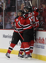 Oct 8; Newark, NJ, USA; New Jersey Devils left winger Zach Parise (9), New Jersey Devils left wing Ilya Kovalchuk (17), and New Jersey Devils center Travis Zajac (19) celebrate Zajac's goal during the first period against the Dallas Stars at the Prudential Center.