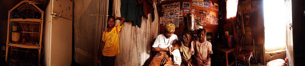 Sunkari and her children (Amadu, 14, Mary, 1, Salimatu, 8 and Agnes, 10) at home, Kroo Bay, Freetown, Sierra Leone.