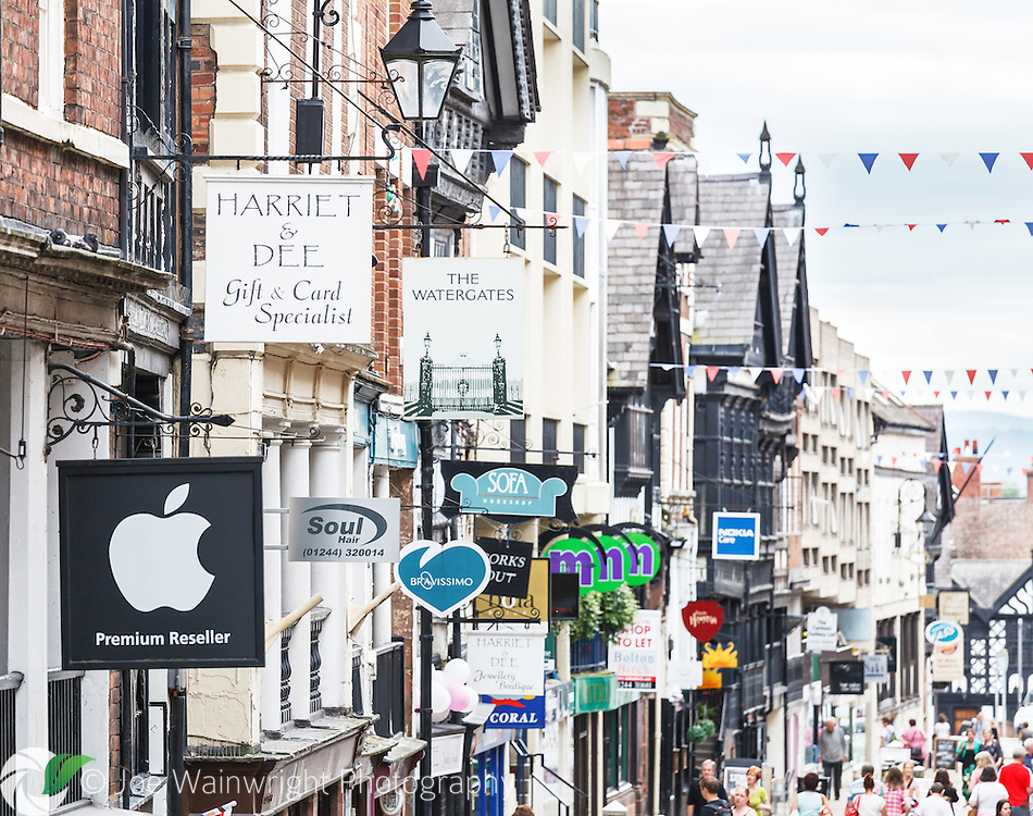 A jungle of signs greets shoppers in Watergate Street, Chester - actually one of the most picturesque and unspoilt streets in the city.  Following the line of the Roman Via Principalis it offers visitors a range of pubs, restaurants, exclusive stores and antique shops.