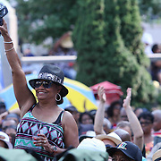 Spectator dances to the music during the 27th DuPont Clifford Brown Jazz Festival Saturday, June 20, 2015, at Rodney Square in Wilmington, Delaware.