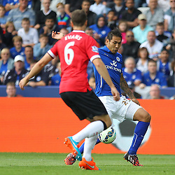Leicester City's Leonardo Ulloa on the ball during the Barclays Premiership match between Leicester City FC and Manchester United FC, at the King Power Stadium, Leicester, 21st September 2014 © Phil Duncan | SportPix.org.uk