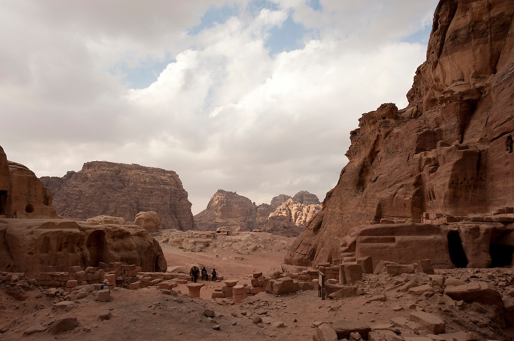 PETRA <br /> <br /> The city of Petra, capital of the Nabataean Arabs, is one of the most famous archaeological sites in the world, it is Located 240 km south of the capital Amman and 120 km north of the red sea town of Aqapa.<br /> <br /> Established possibly as early as 312 BC as the capital city of the Nabataeans, it is a symbol of Jordan, as well as Jordan's most-visited tourist attraction. It lies on the slope of Jebel al-Madhbah (identified by some as the biblical Mount Hor) in a basin among the mountains which form the eastern flank of Arabah (Wadi Araba), the large valley running from the Dead Sea to the Gulf of Aqaba. Petra has been a UNESCO World Heritage Site since 1985.