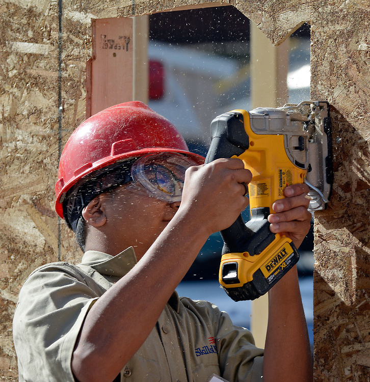jt033117d/a sec/jim thompson/  Juan Mota of Miyamura High School cuts a window opening in a framed in wall during the SkillsUSA  competition on the CNM Main campus in Albuquerque, NM. Friday March 31, 2017. (Jim Thompson/Albuquerque Journal)