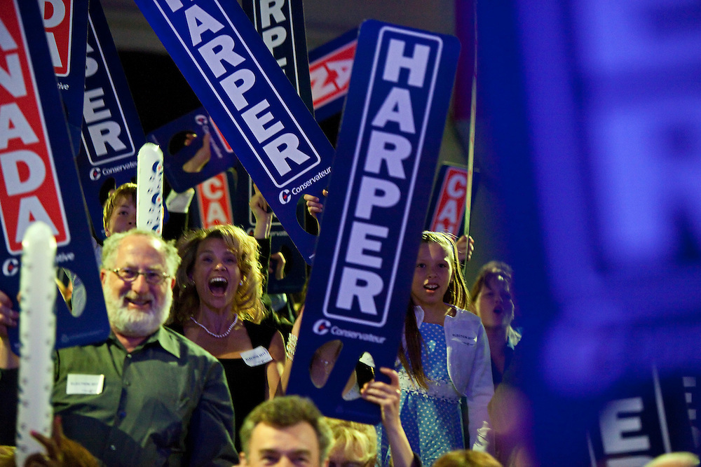 Conservative supporters react to the projection of a Conservative majority government at the Telus Convention Centre in Calgary, Alberta, May 2, 2011.<br /> AFP/GEOFF ROBINS/STR
