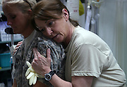 US Major Rebecca Burdick comforts Captain Sarah Bivens as the time of death is called for an Iraqi detainee who had been treated at the 399th Combat Support Hospital at US Camp Speicher  by Tikrit ,Iraq April 15,2007. The Iraqi detainee was severely wounded by US forces who caught him trying to lay Improvised Explosive Devices (IED's)  on a road against US forces. (Photo by Heidi Levine/Sipa Press).