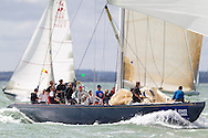 The Italian entry, Italia, races downwind under spinnaker for a second place finish on the opening day of Aberdeen Asset Management Cowes Week. The event began in in 1826 and plays a key part in the British sporting summer 'season'. It now stages up to 40 daily races for around 1,000 boats and is the largest sailing regatta of its kind in the world with 8,500 sailors competing.<br /> Picture date Saturday 2nd August, 2014.<br /> Picture by Christopher Ison. Contact +447544 044177 chris@christopherison.com