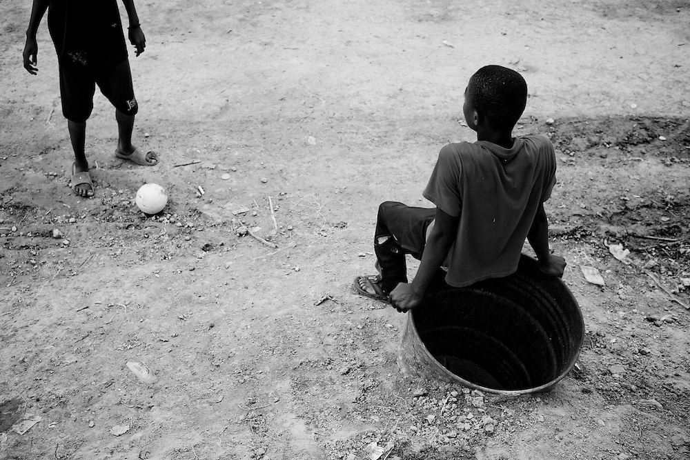 Residents of a camp for those displaced by the recent earthquake play soccer in Petionville, outside Port-au-Prince, Haiti.