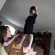 MariAnn Gattelaro, left, plays with her son Sam Gattelaro, 7, at their home in Plano April 23, 2010.  Sam has autism.  He is not very interested in toys or games, but he has impeccable balance and enjoys movement that involves sensory interaction with others.