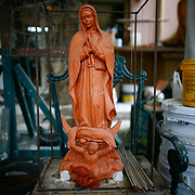 A model of the  Our Lady of Guadalupe statue is shown at a foundry in Mexico City. The statue was commissioned by the historic Our Lady of Guadalupe church in Santa Fe, New Mexico. The statue was commissioned and funds raised after a controversial state-sponsored art exhibit that pushed the boundaries of the sacred and traditional image of Our Lady of Guadalupe. The statue was loaded onto a flatbed truck and driven north, following El Camino Real, the ancient route the Spanish settlers took north to settle New Mexico and the RIo Grande valley.