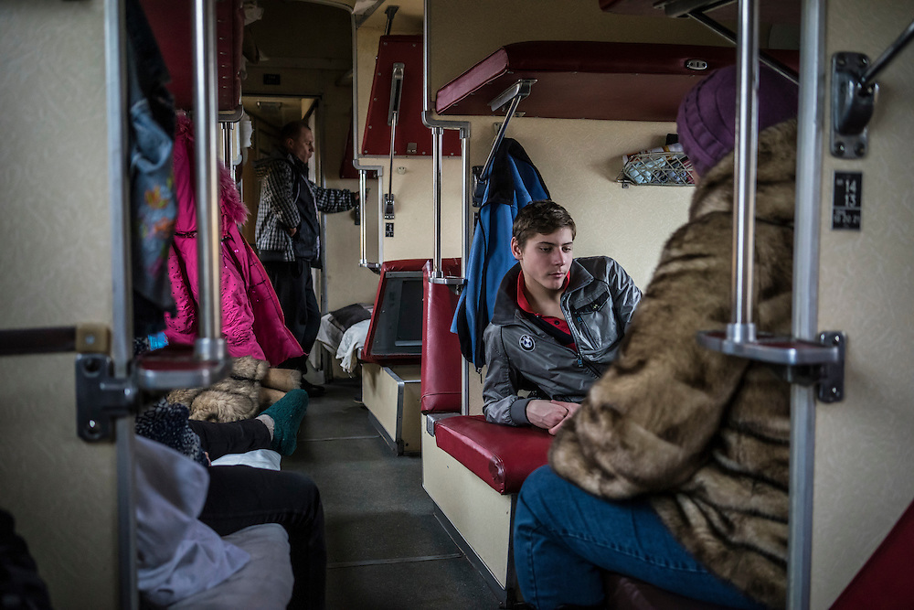 Members of the Ryzhkov family, all of whom fled fighting in the heavily-contested town of Debaltseve, inside the train car where they are living with other members of their extended family at the train station on Monday, February 9, 2015 in Slovyansk, Ukraine.