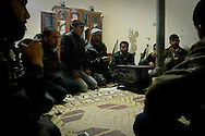 Free Syrian Army soldiers discuss tactics for a night mission to protect the town of Al Janoudiyah, Syria.