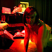 Every week at First Floor, one of Melbourne's underground bars, women pull on frilly underwear and fishnets, froth up their feathers and practice their pouts.  Sounds sexy?  It is.  But it's not some distasteful striptease although the controversial art form has many a debate on the table.  Burlesque is flesh-flashing of course, its primary appeal is sex, but it is suggestive rather than vulgar, sophisticated, stylish and, practitioners say, empowering.  Women of all ages, talents, shapes and sizes are embracing burlesque and giving the century old genre a 21st-century feel.  Image © Arsineh Houspian/Falcon Photo Agency.