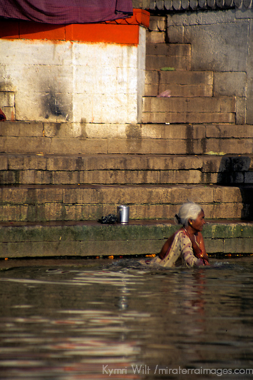 Asia, India, Uttar Pradesh, Varanasi. Scene of daily life along the ghats in the holy city of Varanasi on the Ganges River.