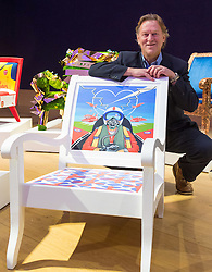 Bonhams, London, February 29th 2016. Artist David Bent poses with his Red Arrows themed chair during a photocall for &quot;Sitting Pretty&quot;, featuring unique, hand painted and upholstered chairs made by 30 celebrities and artists, at Bonhams ahead of their auction in support of a leading AIDS charity, CHIVA Africa.<br /> &copy;Paul Davey<br /> FOR LICENCING CONTACT: Paul Davey +44 (0) 7966 016 296 paul@pauldaveycreative.co.uk