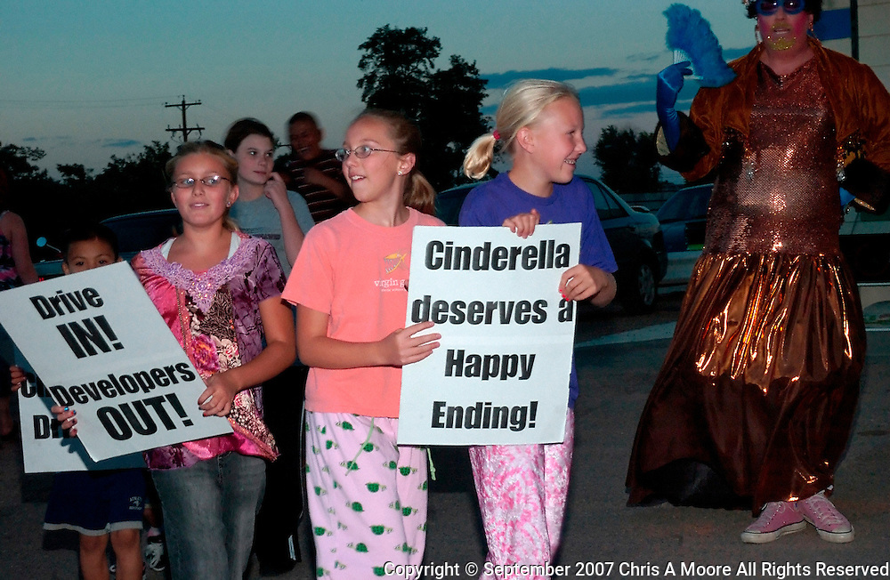 Kids join the Demented Divas in protesting the closing of the Cinderella Twin Drive-in.
