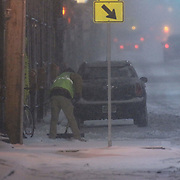 Maintenance worker shovels the sidewalk on E. Main St. during a storm Friday, Jan, 22, 2016 in Newark.<br /> <br /> A massive blizzard dumps snow in Newark, and eastern United States on Friday, with mass flight cancellations, five states declaring states of emergency.