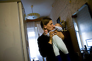 Svetlana, 29, holds her two-month-old son Yuri in her apartment in St. Petersburg, Russia, on Tuesday, September 11, 2007. Svetlana is HIV-positive, as is her husband; both are former heroin users. It won't be clear whether Yuri has HIV until he is a year and a half old. [Names have been changed.]