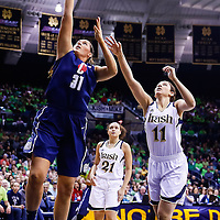SOUTH BEND, IN - MARCH 04: Stefanie Dolson #31 of the Connecticut Huskies shoots the ball against Natalie Achonwa #11 of the Notre Dame Fighting Irish at Purcel Pavilion on March 4, 2013 in South Bend, Indiana. Notre Dame defeated Connecticut 96-87 in triple overtime to win the Big East regular season title. (Photo by Michael Hickey/Getty Images) *** Local Caption *** Stefanie Dolson; Natalie Achonwa