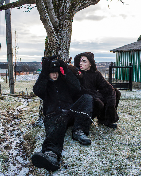 Roman Mytryk, 15, left, and Kostiantyn  Semenovych, 16, wear bear costumes to celebrate the Malanka Festival on Thursday, January 14, 2016 in Krasnoilsk, Ukraine. The annual celebrations, which consist of costumed villagers going in a group from house to house singing, playing music, and performing skits, began the previous sundown, went all night, and will last until evening.