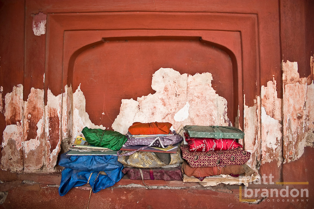 A stack of wrapped Koran's lay against the wall of the Jama Masjid, Old Delhi, India.