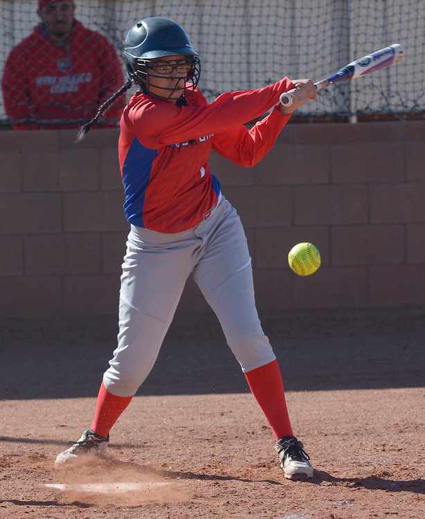 gbs040417l/SPORTS -- West Mesa's Eva Perez gets a hit  in the first  inning of the game against Atrisco Heritage at West Mesa on Tuesday, April 4, 2017. (Greg Sorber/Albuquerque Journal)