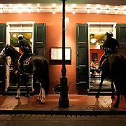 New Orleans mounted patrol officers order takeout from a restaurant on Bourbon Street Friday, Sept. 26, 2008, in the French Quarter of New Orleans, La.<br /> SCOTT MORGAN | ROCKFORD REGISTER STAR
