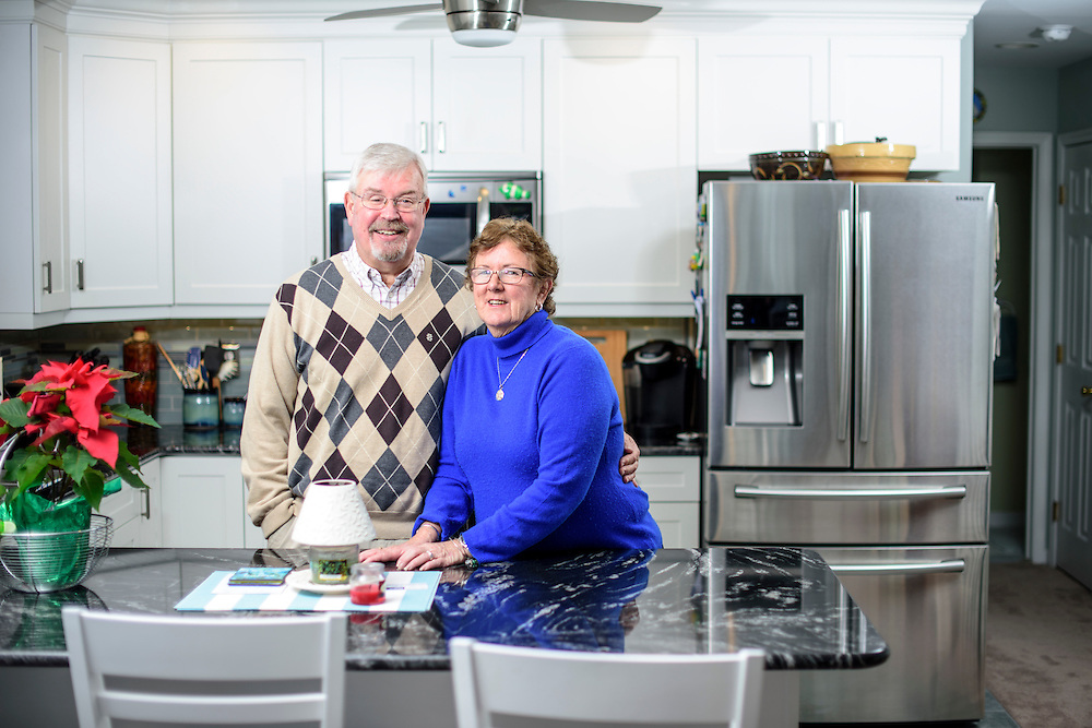 Sea Isle City, New Jersey - January 17, 2017: Ed and Arlene McFadden hang out in the kitchen of their home in Sea Isle City, New Jersey. The McFaddens retired to the Jersey Shore resort town, despite the Garden State's high taxes and housing costs, which is traditionally seen as one of the worst or retirees. A tax change signed into law last year aims to ease the cost burden for New Jersey retirees by increasing the amount of retirement income excluded from income tax. McFadden, who receives a pension, estimated the change will eventually save him $200 to $300 each year.<br /> <br /> <br /> CREDIT: Matt Roth for AARP