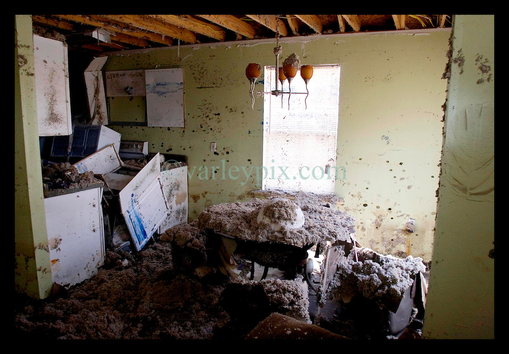 1st Oct, 2005. Hurricane Katrina aftermath, New Orleans, Louisiana. Lower 9th ward. The remnants of the lives of ordinary folks, now covered in mud as the flood waters recede. The mould and toxic mud filled interior of a house rearranged by the floods.