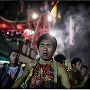 Devotees of the Chinese Shrine of Gim Tsu Ong, near Phuket, Thailand, attend for fire walking ritual.