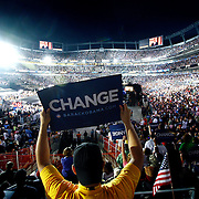 DENVER, CO - Ernie Duran III of Denver, Co. holds a change sign in the south stands at Invesco Field as Barack Obama addressed the more than 70,000 people that gathered to hear him accept the Democratic Party nomination on Thursday August 28, 2008 at Invesco Field in Denver, Co. Duran said he was one of the 50,000 Coloradoans that were granted tickets through a lottery system. Highlighted speakers on Wednesday evening included Howard Dean, former Governor of Vermont and Chair of the Democratic Party; Al Gore, former Vice President of the United States and the acceptance speech of Barack Obama as the Democratic Party candidate for President...(Photo by Marc Piscotty / © 2008)