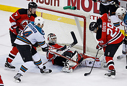 February 20, 2008; Newark, NJ, USA; New Jersey Devils defenseman Paul Martin (7) and New Jersey Devils defenseman Johnny Oduya (29) defend against San Jose Sharks right wing Jonathan Cheechoo (14) as New Jersey Devils goalie Martin Brodeur (30) makes a save during the third period at the Prudential Center in Newark, NJ.  The Devils beat the Sharks 3-2.