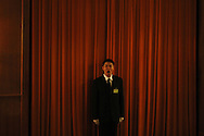 A soldier dressed as an usher yawns before the third plenary session of the National People's Congress, in Beijing's Great Hall of the People Tuesday, March 10, 2009.  The Great Hall of the people's with it's impressive Stalinist building style and attention to protocol remains as one of the the country's last showcases  of old style communism on a grand scale.