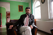 Damir Pestalic, the head Imam of the Srebrenica municipality, in a tea house adjoining the recently rebuilt central mosque of Srebrenica...Matt Lutton for The International Herald Tribune..Capture of Ratko Mladic. Srebrenica, Bosnia and Herzegovina. May 29, 2011.