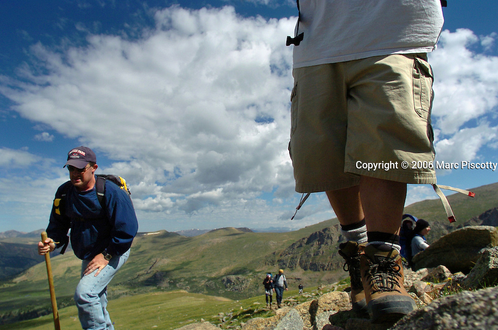 "(GEORGETOWN, Co., SHOT 8/11/2004).About 35 members of the Denver Rescue Mission's ""New Life"" rehabiliatation program climbed to the more than 14,000 foot peak of Mount Bierstadt near Georgetown, Co. Wednesday. Two of the members climbing to the top were Justin Cottrell (left), 32, of Denver and Aaron Pytko, 32, of Conifer. Cottrell has been in the program 31 days and Pytko has been in the program for six months. Both are in the program at the Rescue Mission's Farm location in Wellington, Co. The ""New Life"" program is a long term Christian based recovery program that gives the men involved the tools to become self-sufficient and overcome various addictions. The climb helps the men to set a goal and achieve it and is part of the program..(Photo by Marc Piscotty/ © 2004)"