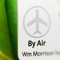 """Close up of """"By Air"""" logo on packet of green beans in UK Super maket."""