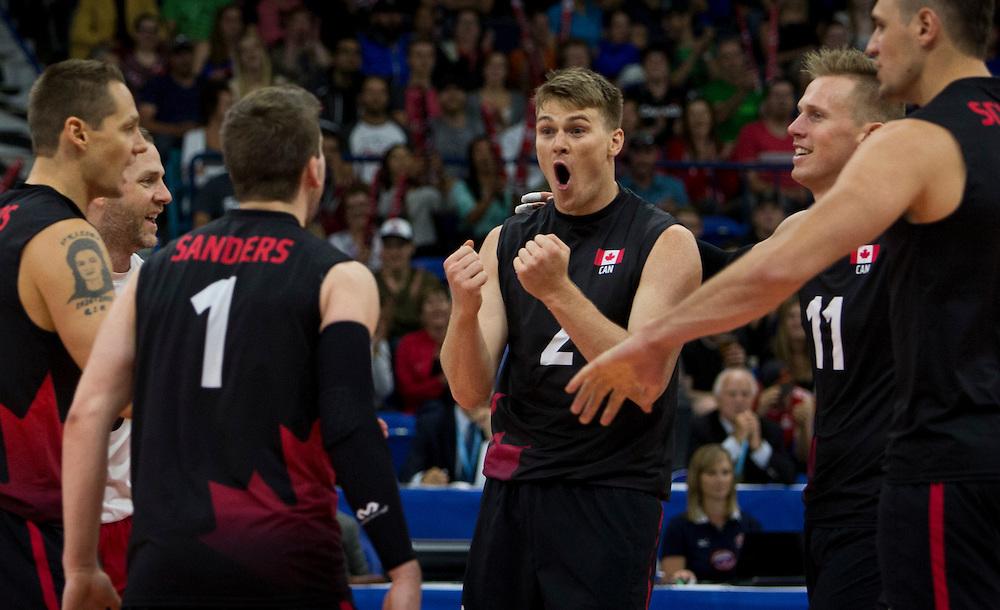 John Gordon Perrin celebrates of winning point for Canada versus China at a World League Volleyball match at the Sasktel Centre in Saskatoon, Saskatchewan Canada on June 25, 2016.
