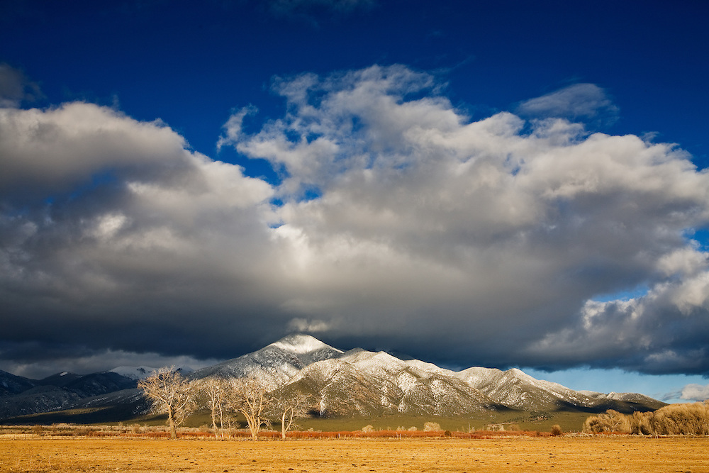 A storm has deposited fresh snow on Pueblo Peak. Taos, New Mexico.