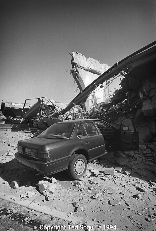 A Honda crashed out in to a fallen 14 freeway interchange at the I5.<br /> Northridge earthquake.