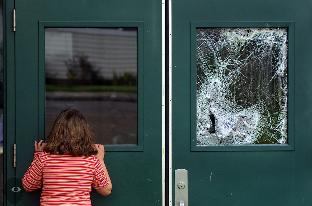 Fire does about $1 million in damages to Oliver P. Lent Elementary School. Amanda Snyder, 7, is a second grader there and checks to see what she can see inside. It is unclear whether the window was broken by the possible arsonist or by police/fire ubits responding.