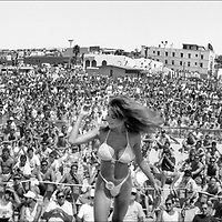 This girl loved to twirl around and show off her assets. In the corner you can see the always professional MC Sam Laganà (reading his index cards). Men's AVP $150,000 Miller Lite U.S. Championships August 26-27, 1989 Hermosa Beach, California From Widelux Beach available at Kim Reilly Arts on Manhattan Ave. in Manhattan Beach, California. (310) 372-3681