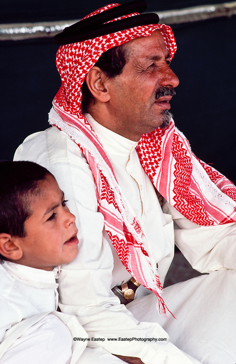 Jaber, Shaikh of the Al Amrah tribe sharing time with his youngest brother Faisal. Dahana Sands, Saudi Arabia