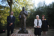 Sculptor Bill Beckwith (left) with donors Martha Lyles Wilson (center) and Virginia Wilson Mounger at the dedication of the LQC Lamar statue at the LQC Lamar House in Oxford, Miss. on Saturday, October 9, 2010.