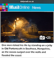 A man risking his life during one of the storms of 2014 in Old Portsmouth, Hampshire, UK - http://www.dailymail.co.uk/news/article-2560052/UK-weather-More-140-000-homes-left-without-power-80mph-storms-forecasters-warn-MORE-rain-flooded-areas.html